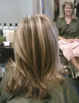 Dark blond base hair color, Blond Hi-lite, layered cut